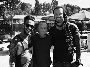 Mark Needham with Michael Franti and Spearhead guitarist Jay Bowman